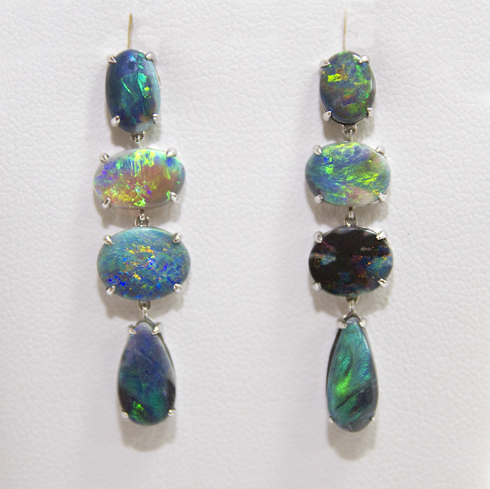 Four stone, black opal, dangle earrings set in 18 karat white gold