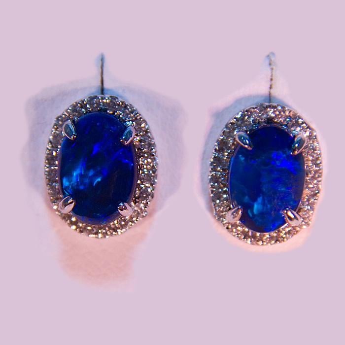 Black Opal and diamond earrings in a classic design.  The opals weigh 1.56 carats total accented by .28 carats of fine white round brilliant cut diamonds, set in 14k white gold.