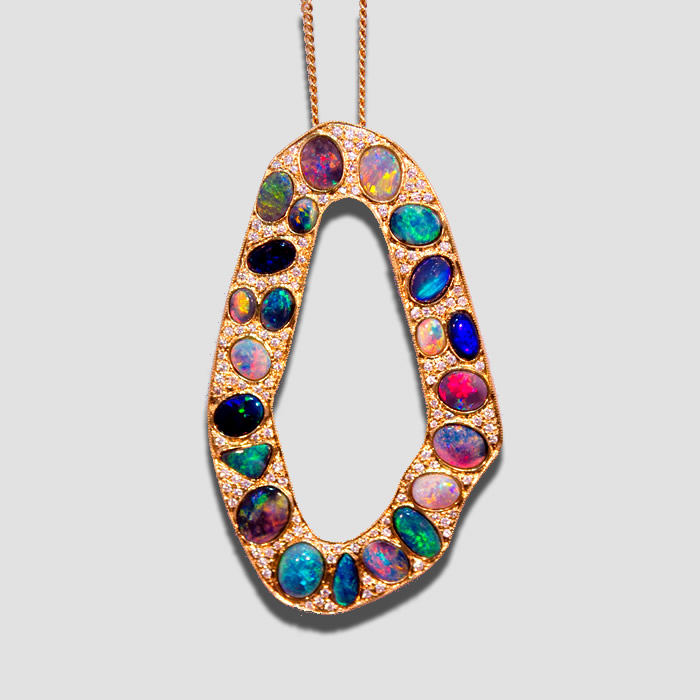 Multi colored Black Opal and diamond pendant, containing 22 Lightning Ridge Black Opals of different colors
