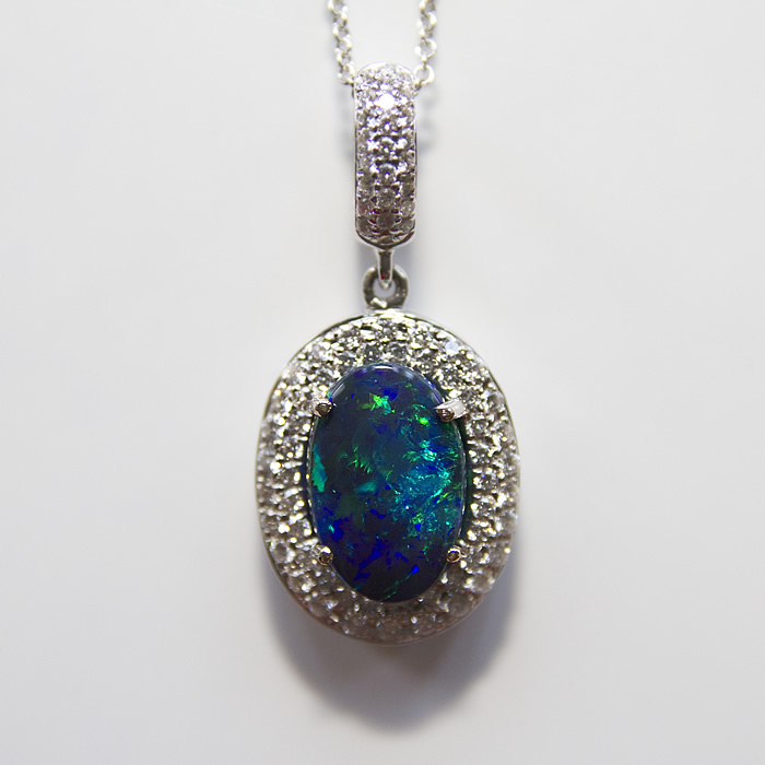 Ladies Opal and Diamond pendant, oval 2.85 carats of fine black opal accented with .75 carats of fine white brilliant cut diamonds set in 18 karat white gold