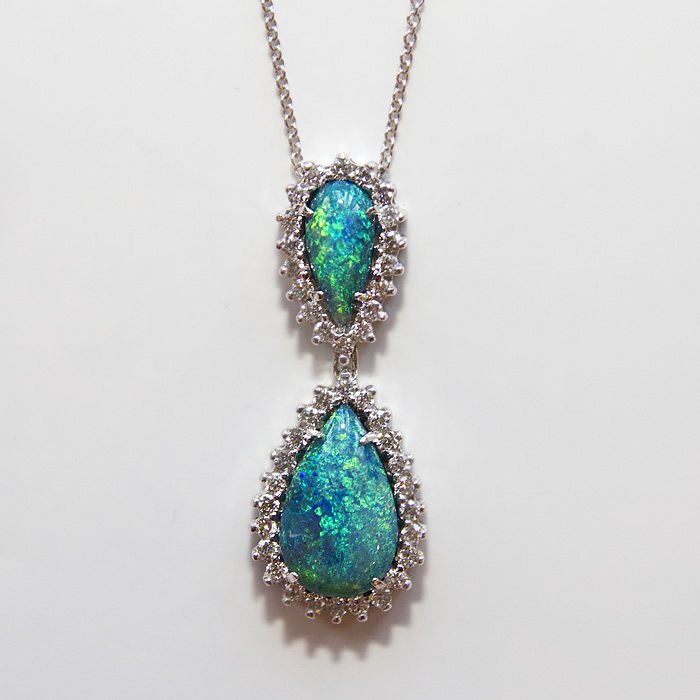 Black Opal Opal pendant with 7.19 carats of black opal accented with 1.26 carats diamond