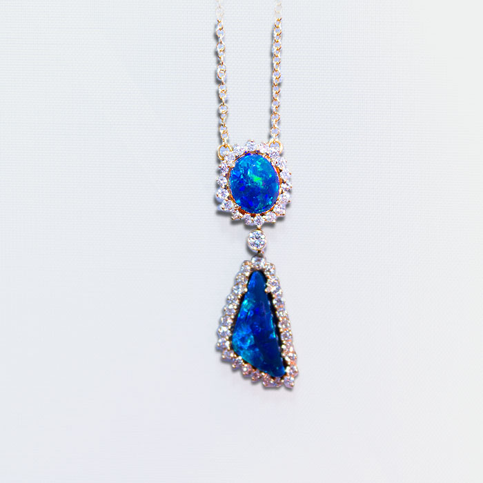 Black Opal and diamond necklace, one oval and one free form Black Opal make this necklace unforgettable. 4.07 carats of black opal are accented by .66 carats of fine white brilliant cut diamonds, set in 18k yellow gold