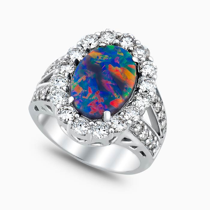 Ladies Black Opal and diamond ring, with multi colored black oval opal with red flash