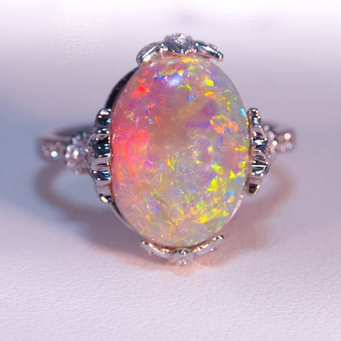 Ladies fine white Lightning Ridge opal.  This 4.82 carat white opal with extraordinary green, orange, yellow and red colors
