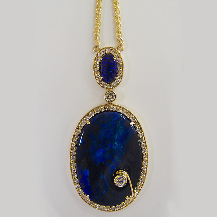 Ladies Necklace with 30.25 Carats of Black Opal accented with a 1.95 carat diamond set in 18 karat yellow gold