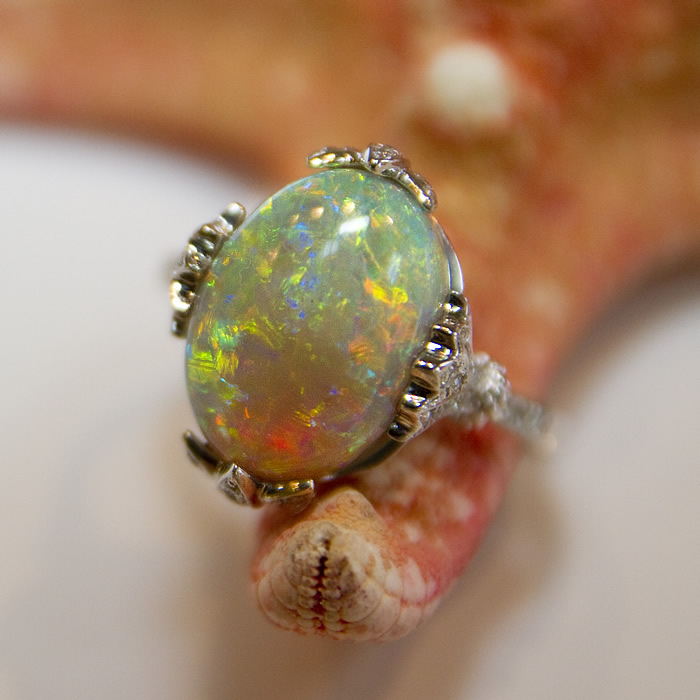 Black opal ring with a 4.82ct center stone and .38cts of diamonds