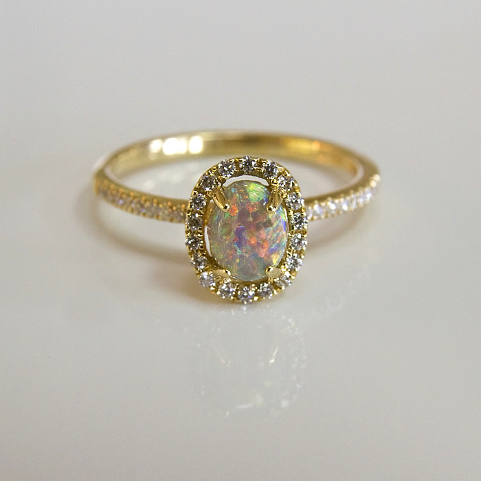 18 karat yellow gold the .56ct black opal center stone sparkles just as brilliantly as the .22cts of diamonds that frame it