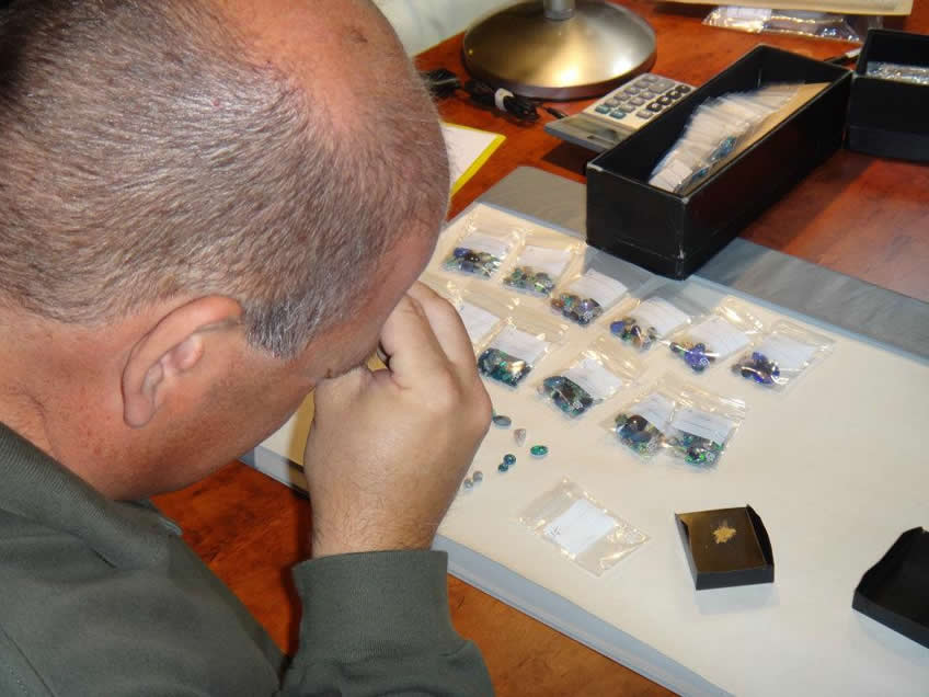 inspecting Lightning Ridge Opals